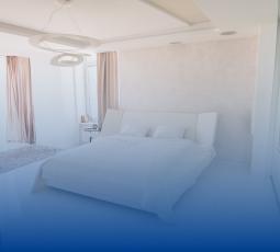 interior-of-cozy-bedroom-with-comfortable-double-b-FZ2CKCR 1